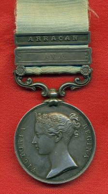 Army of India Medal 1799-1826 Short hyphen reverse, 1 clasp, Ava, with contemporary silver slide clasp inscribed 'Arracan'. Capt J. Clarke Brig. Maj.