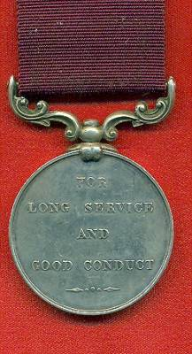 Army Long Service and Good Conduct Medal Victoria issue, 3rd type 1874-1901, swivelling scroll suspension with smaller reverse lettering. 1069 Sergeant J. Moore, 14th Bde. Royal Artillery