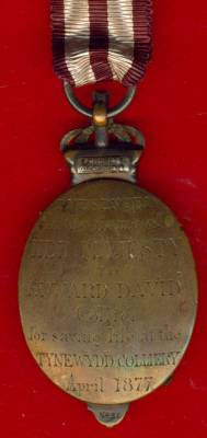 Albert Medal 2nd Class for gallantry in saving life on land in bronze, reverse officially engraved 'Presented in the name of Her Majesty to Edward David, Collier, for saving life at the Tynewydd Colliery April 1877', reverse of the crown with marker' cartouche Phillips, Cockspur St., and officially numbered 'No 31'.